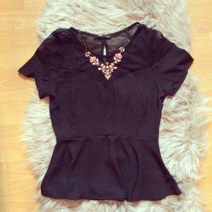 Schwarze Peplum Bluse