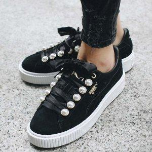 schwarze Puma Suede Sneakers