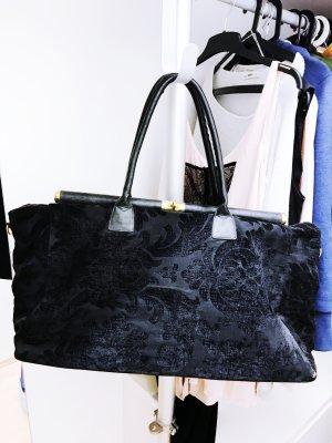 Schwarze Reisetasche mit Muster