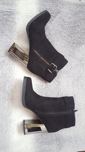 Schwarze Reißverschluss Stiefeletten mit silbernem Blockabsatz