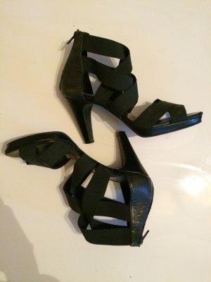 Schwarze Sandaletten mit elastischen Riemen