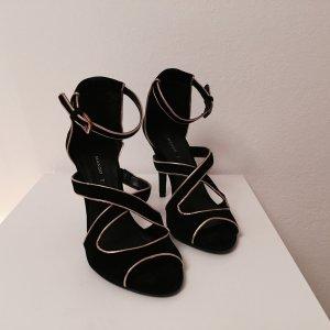 Schwarze Sandaletten mit Goldverzierung