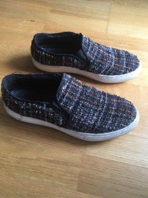 Schwarze Slip on Sneaker