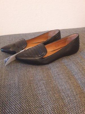 Schwarze Slipper von H&M in Echtleder