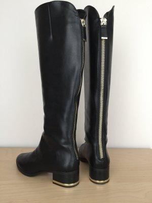 Schwarze Stiefel mit goldenem Reißverschluss