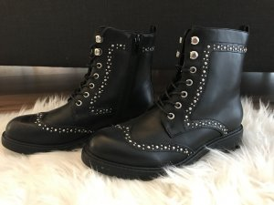 Botas con cordones negro-color plata