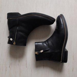 Schwarze Stiefelette mit goldenen Details COX 41