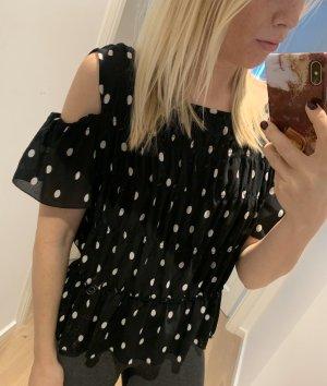 Schwarze T-Shirt-Bluse mit weißen Punkten von zara