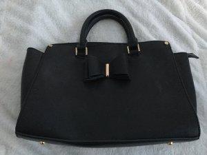 Schwarze Tasche mit Schleife