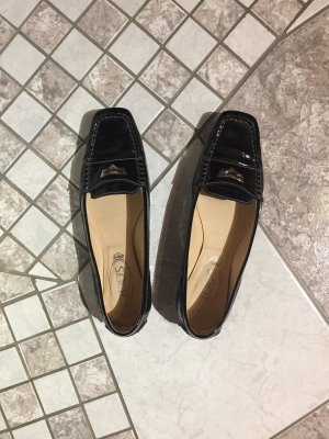schwarze Tod's Schuhe