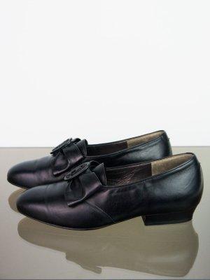 Schwarze Vintage Lederschuhe mit Schleife