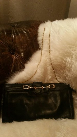 Clutch black-gold-colored leather
