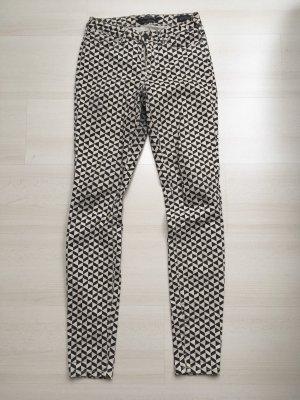 Schwarze weiße Skinny Hose