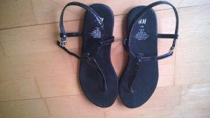 Schwarze Zehentrenner-Sandalen