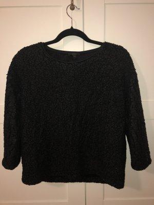 Schwarzer COS Pullover mit besonderer Struktur