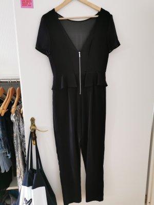 Schwarzer Jumpsuit mit tiefen Ausschnitt und Reißverschluss vorne