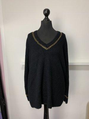 Schwarzer langer Pullover (Teilverzierung Gold)