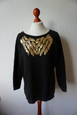schwarzer Oversize- Pullover mit Pailletten