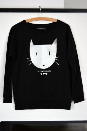 Schwarzer Pullover mit Katzen Motiv und Aufschrift Un Chat Mignon