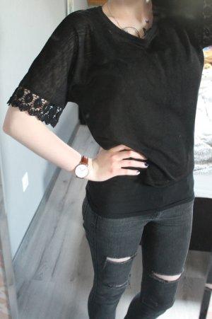 Schwarzer Pullover mit kurzen Ärmeln