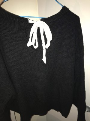 Schwarzer Pullover mit Masche