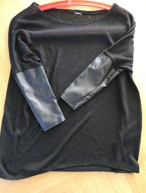 Schwarzer transparenter Pullover
