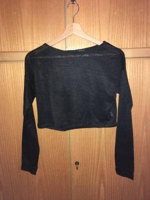 schwarzes bauchfreies Shirt