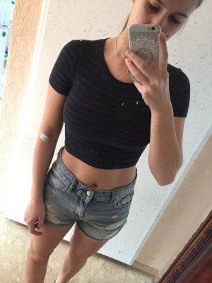 Schwarzes bauchfreies t-Shirt