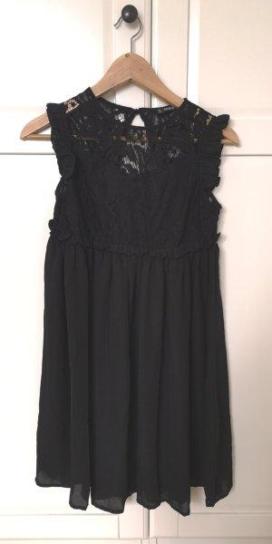 Schwarzes Chiffonkleid mit Spitze und Rückenausschnitt