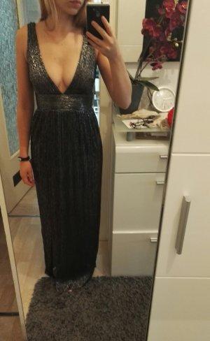 Schwarzes glitzerndes Kleid mit tiefem Ausschnitt