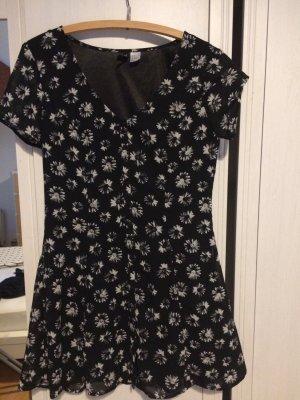 Schwarzes Kleid mit Blumen Divided