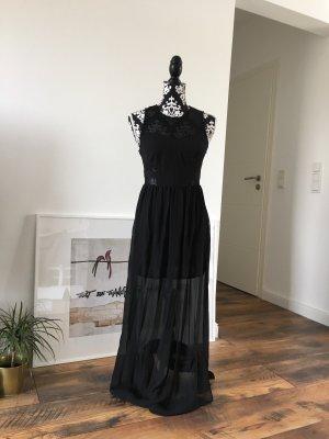 Schwarzes Kleid mit Cutouts