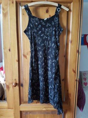 Schwarzes Kleid mit Glitzer Stickerei und assymetrischem Saum