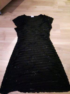 Schwarzes Kleid mit leichtem Glitzer