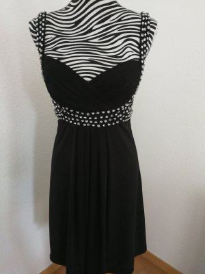 Schwarzes Kleid mit Steinchen