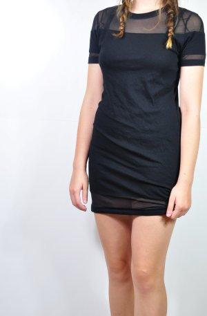 Schwarzes Kleid mit transparenten Ausschnitten