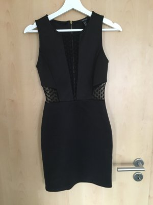 Schwarzes Kleid mit Transparenten Einsätzen