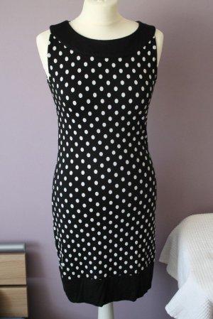 schwarzes Kleid mit weißen Punkten von BrunoBanani