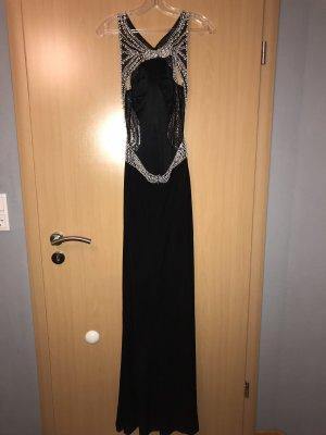 Schwarzes Kleid mit Zierperlenbesatz