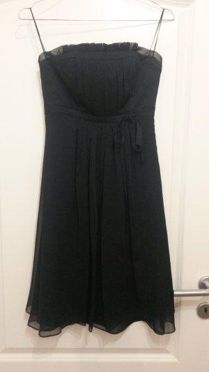 schwarzes Kleid von Marie Blanc mit Schleife