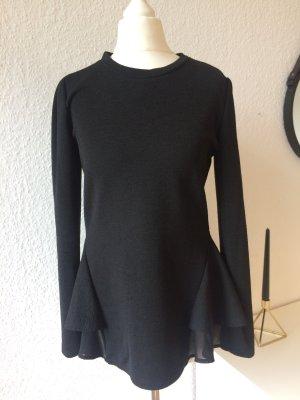 Schwarzes Langarm Oberteil mit schößchen | schwarz