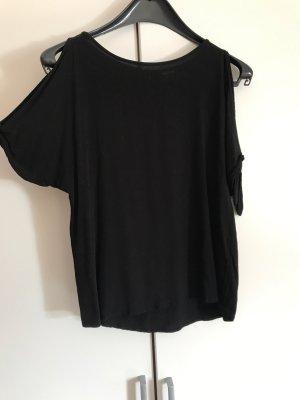 Schwarzes lockeres tshirt, leicht schulterfrei