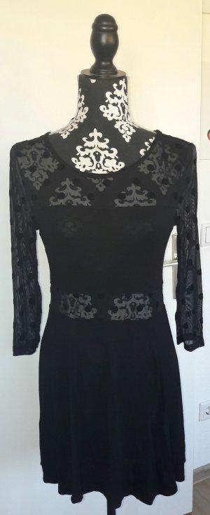 schwarzes Minikleid mit durchsichtigem Muster und Samt