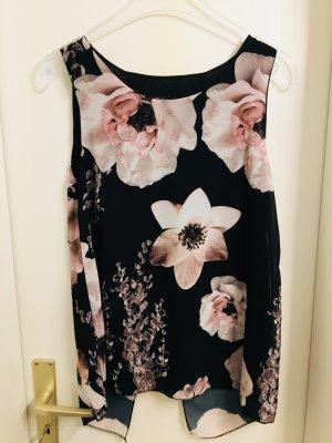 Schwarzes Oberteil und rosa Blumen
