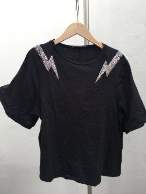 Schwarzes Shirt mit Glitzer Blitzen