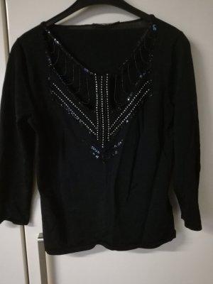 Schwarzes Shirt mit interessanten Ausschnitt