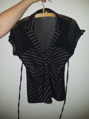 Schwarzes Shirt mit Knöpfen