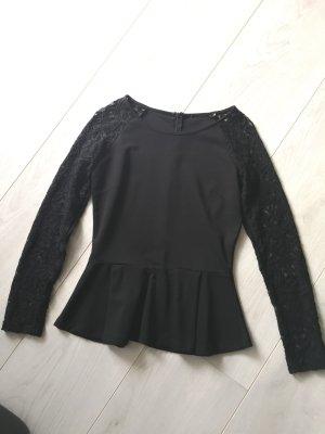 Schwarzes Shirt mit Peplum