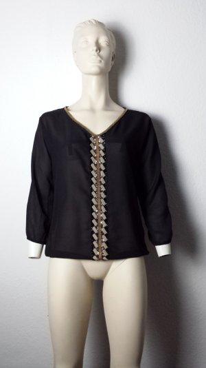 Schwarzes Shirt mit Verzierung vorn Gr.34