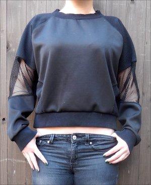 Schwarzes Sweatshirt von Sparkle & Fade - Cut-Outs mit Netz an den Ärmeln